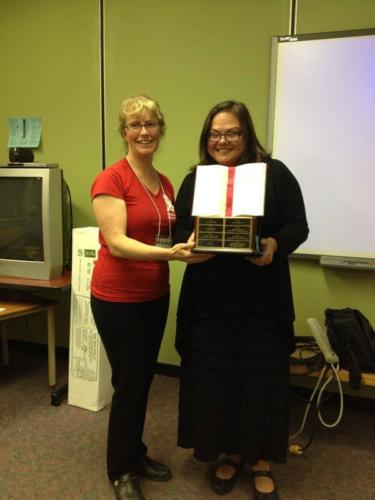 """Paula presents the Best Adult Novel in this year's Muskoka Novel Marathon to Tena Laing for """"We to Me"""". ~ Picture by Tara Whitwell."""