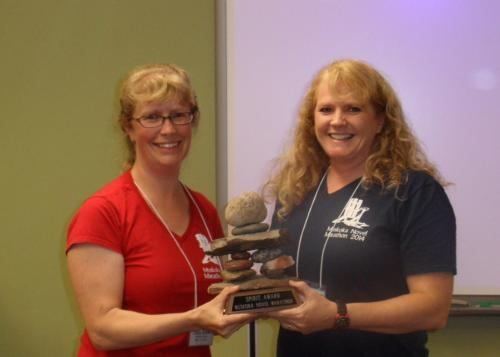 Paula presents the Spirit Award to Lori Twining.