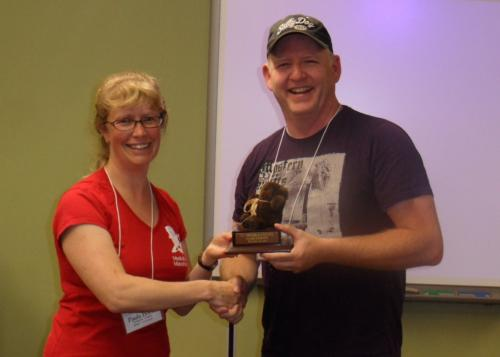 Paula presents Rookie, Dale Long with the Rookie Award.