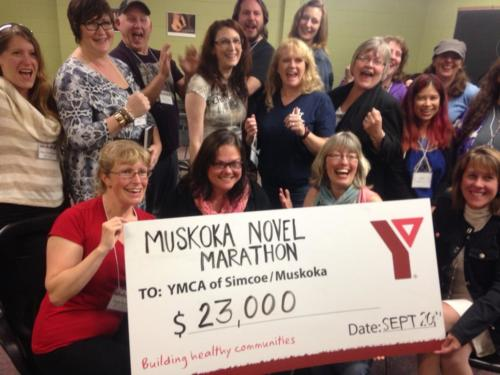 First official pic of the 2014 Muskoka Novel Marathon amount donated to YMCA Literacy programs! $23,000. FANTASTIC! You writers ROCK!
