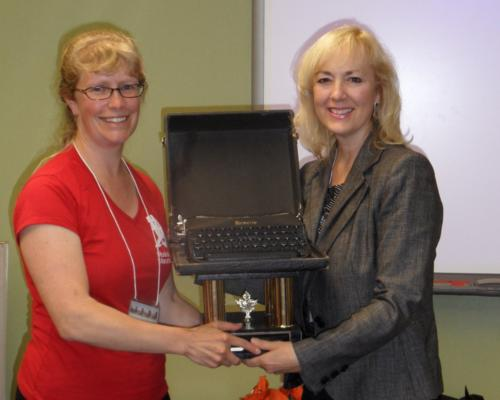Cheryl Cooper receives the Remy Award from Paula, for most funds raised for this year's marathon.