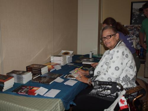 Wendy selling MNM Author Books ~ Photo by Lori Twining