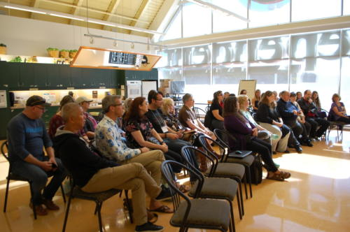 Writers and volunteers listen to Kate's welcome address