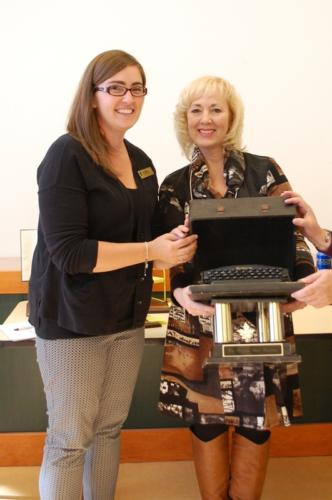 Kate Meeks presents the Remy Award for most funds raised to Cheryl Cooper, who raised $3,050 this year