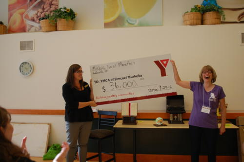 Nancy West (right), Team Leader for Employment and Literacy Services at YMCA of Simcoe Muskoka in Huntsville, reacts to the amount raised at this year's marathon