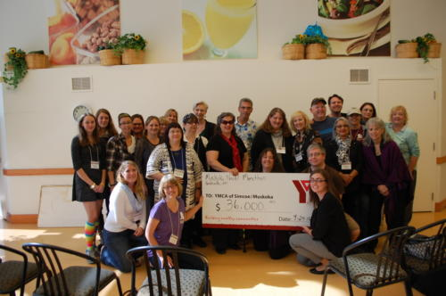 Some of the 2016 writers and volunteers present the cheque to YMCA of Simcoe Muskoka