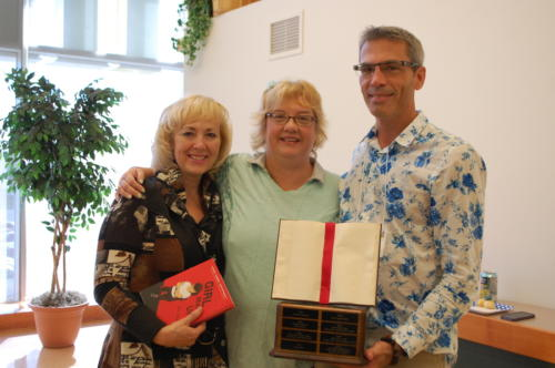 Remy Award-winner Cheryl Cooper with Best Novel winners Lori Manson (YA) and Kevin Craig (Adult). Cheryl is holding a copy of previous MNM writer M-E Girard's YA novel, Girl Mans Up